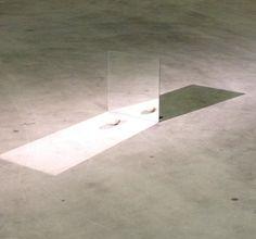 Wilfredo Prieto, A mirror and two stones on ArtStack #wilfredo-prieto #art