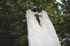 A #weddingdress hanging from an apple tree during an #outdoorwedding in #PoulsboWashington.
