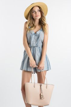 Striped chambray is forever timeless and chic! This sleeveless airy romper is…