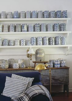 beautiful display of blue-and-white spongeware pitchers and dishes dating to the late 19th and early 20th centuries