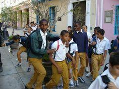 Kids ins school uniforms...