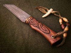 Forged by David DelaGardelle, Hildeofor is a composite twist pattern welded Germanic style broken backed hunting seax.