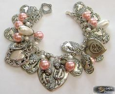 gorgeous vintage sterling silver hearts & pearls charm bracelet.  Love the pink pearls<3
