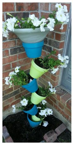 Painted and stacked flower pots.