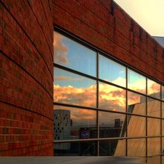 where_is_nico day265: Sky on fire at UC. #cincinnati #sunset #clouds #fire #sky #nofilter #texture #reflection #mirror #daily #inspiration #photography #iphoneography #art #iphoneonly #picoftheday #photooftheday #architecture #uc #universityofcincinnati #uofcincy #campus