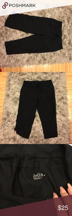 Capri track pants Zella size 12 Capri track pants. Nylon windbreaker material preowned by my sister who only wore them a couple of times. Great condition! Zella Pants Track Pants & Joggers