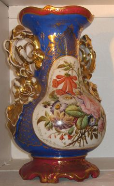 Period: 19th century 		 				 			Description Antiquité: 			 			Vase Porcelain Paris End XIXth Century.  		Paris porcelain vase, second half of nineteenth century, in the style of Jacob SMALL. Flower decoration, gilding on the handles (some wear).