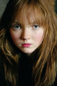 lily cole. apparently, we look alike. I wish! She's gorgeous.