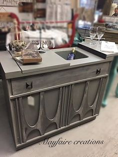 Mayfaire Creations updated this vintage server.  Using CeCe Caldwell's Chalk and Clay Paint in Seattle Mist and CeCe Caldwell's Stain + Finish in Beechnut Gray and Walnut Grove they really knocked it out of the ballpark with this finish!