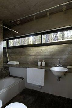 #concrete #bathroom with high horizontal windows