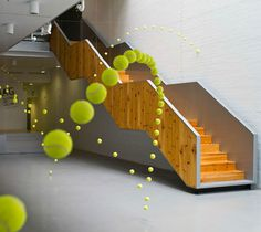 """""""Causa-Efecto"""" (""""Cause & Effect""""; 2012), by Ana Soler. Installation using 2000 tennis balls, Mustang Art Gallery, Alicante, Spain"""