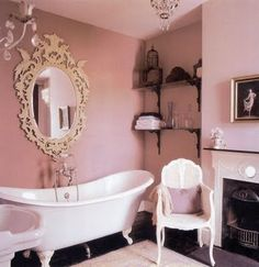 That mirror..that tub...that fireplace. LOVE bathrooms like these!