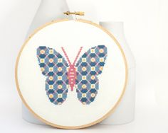Cross stitch pattern PDF - Patterned butterfly in blue, pink, and yellow. $4.00, via Etsy.