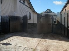 Trackless Bi-fold Automatic Gates - custom made steel picket - The Motorised Gate Company - Melbourne, Australia. Visit us @ www.themotorisedgatecompany.com.au