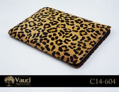 The cheetah might be the fastest land animal, but we love it for its softness and durability! Hand-stitched, leather laptop sleeve. www.vauci.com