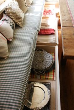 I want either drawers like this under the banquette or cabinets that open. I think drawers might be better. The table needs to be a pedestal table so it will be easy to get in and out of the banquette seating area.