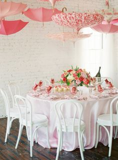 Feminine, pink, umbrella themed shower inspiration. We have seen a lot of umbrella decor around lately.
