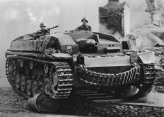 StuG III tank destroyer-unique photo to see a Stug moving with the crew up.