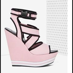 """#5114 Steve Madden Iggy Azalea Patra Neoprene The only thing we love more than Iggy Azalea is her insane shoe collab with Steve Madden. Their Patra Platform is made in pink neoprene and features black piping, wedge silhouete, wrap design, peep toe, and buckle closure. Killer with all things bodycon, or teamed up with boyfriend jeans and a neon crop top.*Synthetic Materials  *Shoe height: 10""""/25.5cm  *Heel height: 6.5""""/16.5cm  *Platform height: 2""""/5cm  *True to size  *Imported Steve Madden…"""