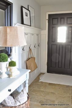 Benjamin Moore Gray Owl is one of the best light gray paint colours. Shown in entryway with dark painted front door.mirror matches the door Light Grey Paint Colors, Paint Colours, Neutral Paint, Benjamin Moore Grey Owl, Home Interior, Interior Design, Interior Architecture, Front Hallway, Entry Wall