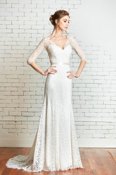 This floral lace bodice is a beautiful cover up option with ¾ length sleeves and a classic v neck bodice. Ivory covered buttons gracefully finish the full length of the back. It is a great addition to any of our simple slip or strapless gowns, being perfectly classic as well as sophisticated. Available in Ivory Floral Lace ¾ length sleeve Covered buttons center back fastening  This top is cut-to-order and requires approximately 16 weeks to produce. We do offer a free rush option of up to 6…