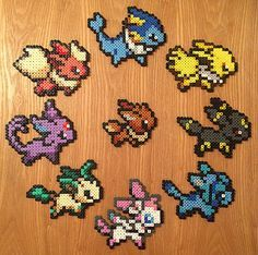 Super-cute Pokemon Eeveelutions, handmade using midi Hama Beads!  Simply select your favourite from the drop-down menu. Choose from:  - Eevee (9cm x 8cm) - Vaporeon (13cm x 10cm) - Jolteon (11.5cm x 8.5cm) - Flareon (12cm x 9cm) - Espeon (11cm x 10.5cm) - Umbreon (11.5cm x 9.5cm) - Leafeon (12cm x 9cm) - Glaceon (11cm x 9cm) - Sylveon (11cm x 10.5cm)  Both sides have been ironed for extra strength and durability. Colours may vary slightly.  If you are purchasing the complete collection…