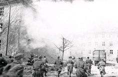 Soldiers of the 3rd Belorussian Front fleeing the attack on one of the streets of Koenigsberg.