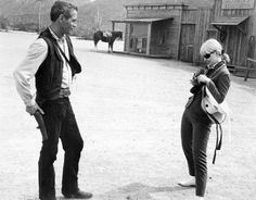 "Joanne Woodward taking a picture of Paul Newman on the set of his film ""Hombre."""