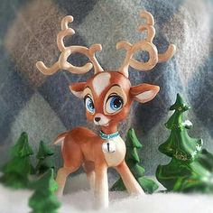 Cute Kitsch Reindeer Sculpture by I Do Cake Toppers, via Flickr sculpted in Polymer Clay by artist Christina Patterson