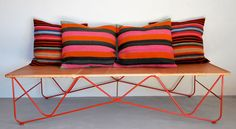 beautiful saddle leather cot from garza marfa + vintage frazadas for pillows from l'aviva home