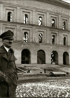 Hitler inspecting the progress of a Berlin-based construction project of a Neo-Classical, Roman Empire-inspired sports Colosseum. It only reached partial completion however due to increasing demand of resources due to the outbreak of war, though what was completed remains standing in Berlin to this day.