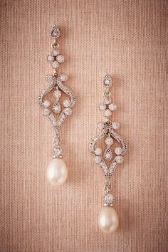 Jewelry seems to be an afterthought rather than a priority when it comes to styling your bridal look. However, the right jewelry can really express your personality and complement your dress. If your style is elegant and classic, your wedding jewelry shouldn't be dipping with diamonds or colorful gems, consider making a timeless statement with …:  Wedding ideas