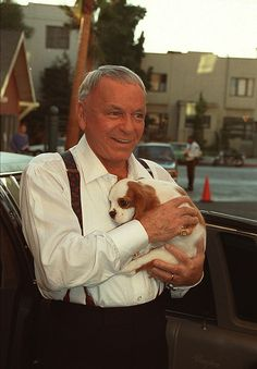 Frank Sinatra with one of his many King Charles Cavalier spaniels, November 5th, 1990