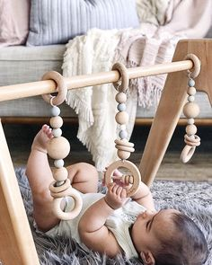 The Modern Monty Deluxe Wooden Play Gym with Minimalist Toys in Grey Storm. So stylish and baby loves them!