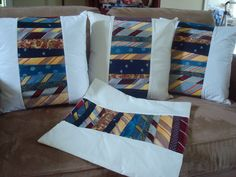 Pillows made from ties and men's dress shirts--the button front of the shirt is on the back to open the pillow cover