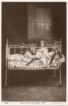 HUMOR: This portrait of a child in a crib with a small arsenal may be  for protection  against the boogeyman. It is unique, eye catcher.