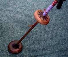 I LOVE the idea of this disk on the floor.  It would make it so much easier!  Not to mention how much more you could spin on this spindle!