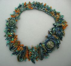 by Marcie Stone I love the use of the different seed beads used.