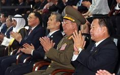 North Korea's National Defense Commission Vice Chairman Hwang Pyong So, second right, and Choe Ryong Hae, right, North Korea's ruling Workers Party secretary, clap with South Korean Prime Minister Chung Hong-won and South Korean President Park Geun-hye's National Security Adviser Kim Kwan-jin, third from right, ... (AP Photo/Yonhap, Bae Jae-man) KOREA OUT ▼4Oct2014AP 2 Koreas meet for highest level talks in 5 years