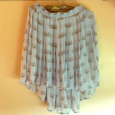 Bird print blue skirt Super cute high low skirt. Blue with white and black birds. Pleated all the way around. Skirts High Low