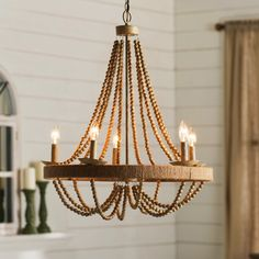 Features:  -Tremiere collection.  -Number of lights: 5.  Product Type: -Candle-Style chandelier.  Finish: -Beige.  Material: -Metal.  Number of Lights: -5.  Wattage: -60 Watts.  Bulb Type: -Incandesce