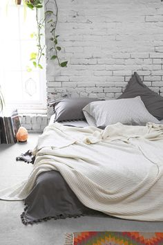 4040 Locust Waffled Bed Blanket. Waffle blankets are warm doublers in winter, and lightweight beathables in summer. Get a few boring cheap white ones and dye 'em a great green or turquoise or yellow.