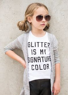 "We all know that one fashionista who adores any type of glitter. With the bold statement of ""Glitter is my signature color,"" this graphic tee will complete any sparkle-loving fashionista's wardrobe."