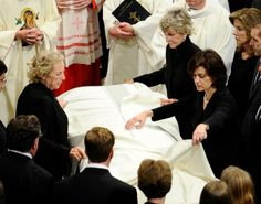 Ted Kennedy's funeral - the women of his family place the cover on the casket for the Mass, his wife Vicki, his sister Jean, his sister-in-law Ethel.