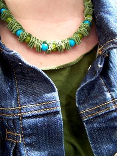 @ElsieFlanigan 's bead necklace tutorial. Ribbon, beads, small needle & embroidery floss. Layers of ribbon fan-folded between each bead. Tie bow at back of necklace. Cute!
