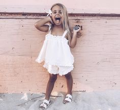 ♡ LINE BOTWIN ♡ Posing pretty. I love the white dress and white shoes, but the flower in her hair and sand on the ground definitely put the picture together. Little Girl Fashion, Toddler Fashion, Kids Fashion, Fashion Clothes, People And Baby, Cute Kids, Cute Babies, Bebe Love, Kids Outfits