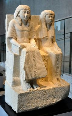 Limestone seated figures of Sibe and his wife.New Kingdom,19th Dynasty c.a. 1220 B.C.