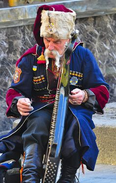 https://flic.kr/p/6eieWq | Cossack playing music | Taken in Kiev (Ukraine) with Leica Elmarit APO 180mm f/2.8 lens on Nikon D300 body adapted with Leitax bayonet. Old man in Cossack traditional dress plays music in the street