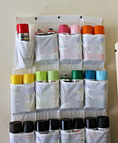 Use a shoe rack in the garage for spray paint and spray adhesives