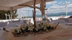 drift wood boat with flower decoration